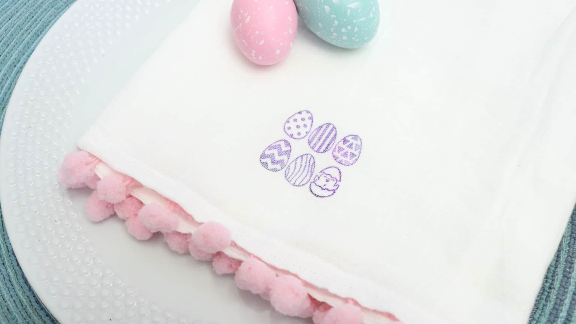 Easter towel with pom poms and stamped fabric
