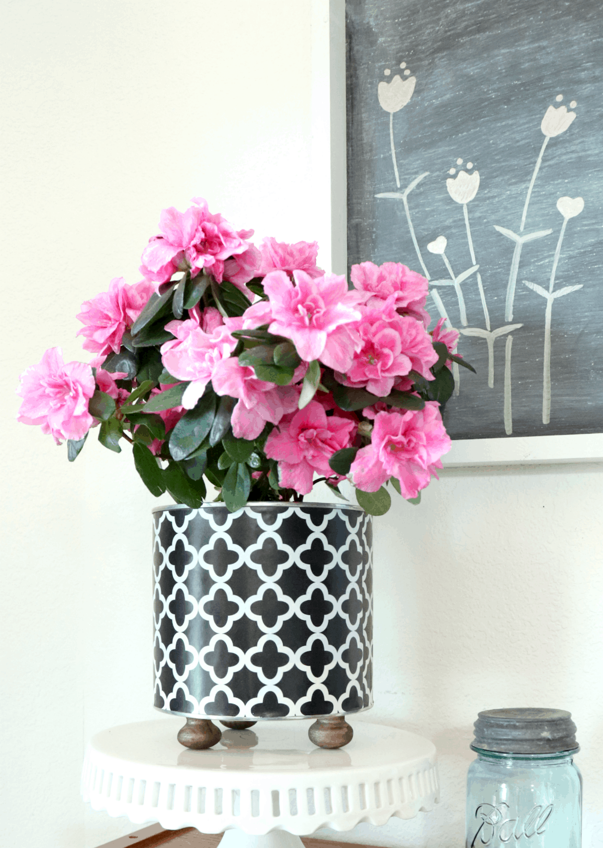 Learn how to make a coffee can planter with metallic feet and pink flowers