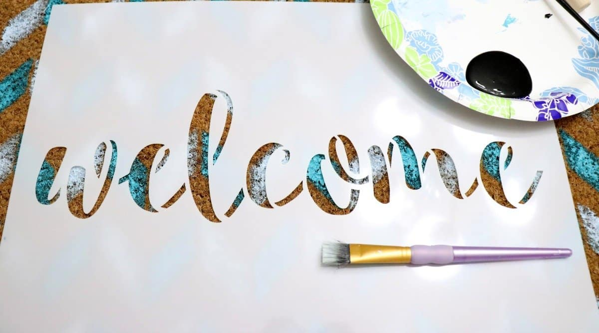 Stencil welcome on an Ikea door mat