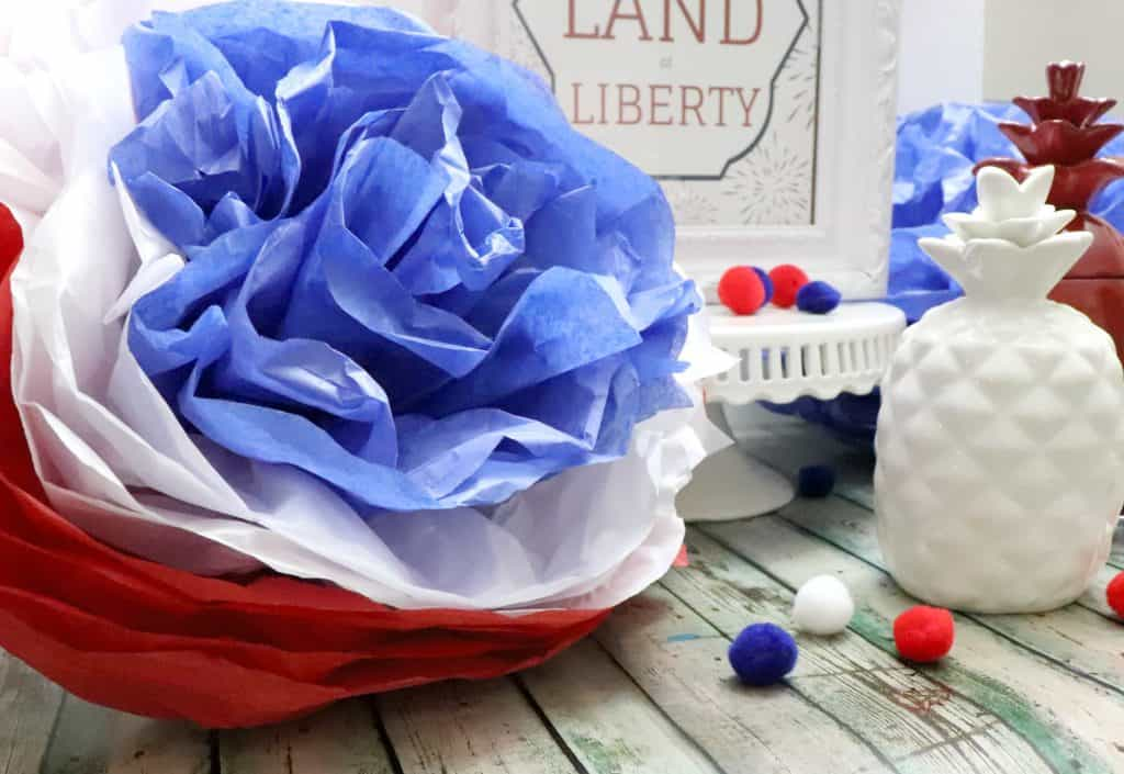 red white and blue tissue paper pom pom