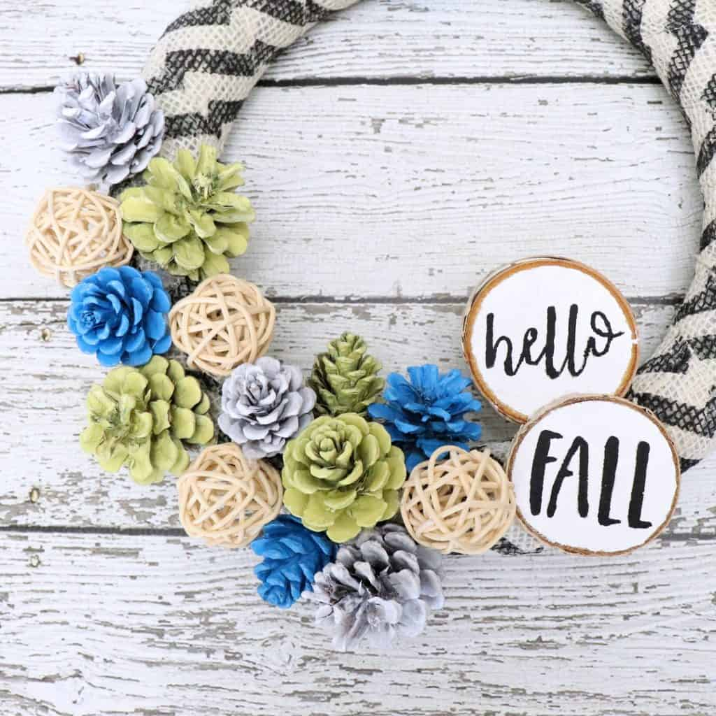 hello fall pinecone wreath with wood slices - blue and yellow