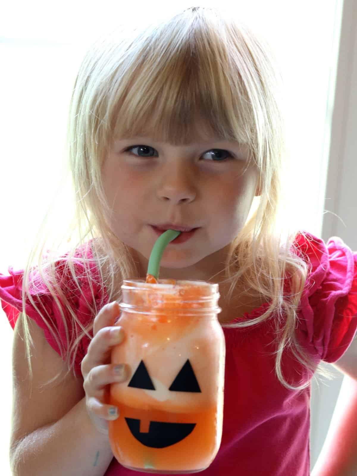 Mason jar jack o lantern with an orange float