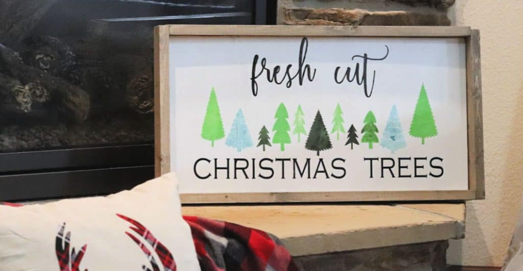 Fresh cut trees framed wood sign
