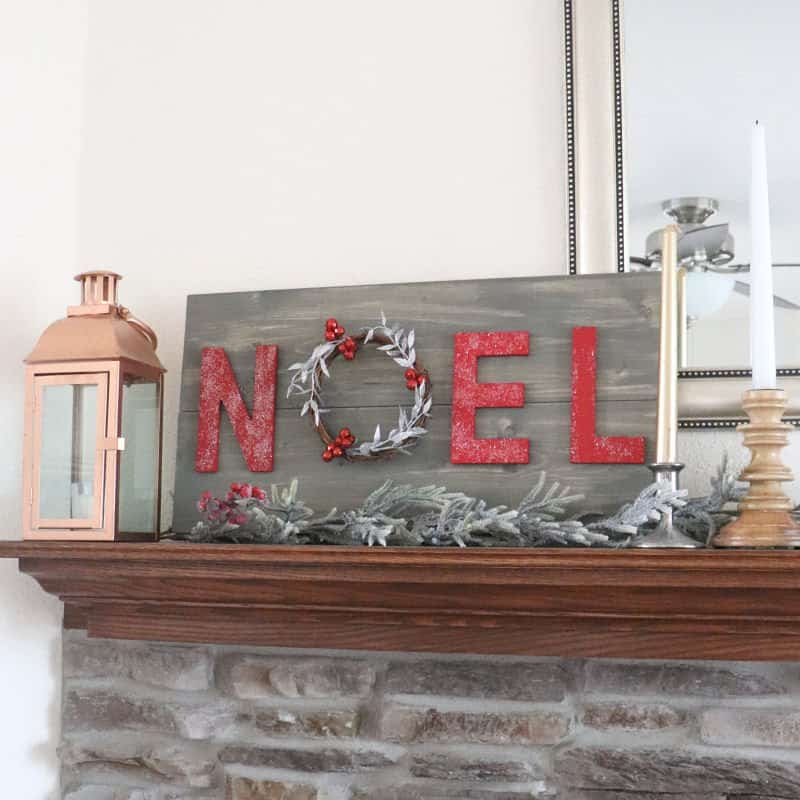 noel wreath sign on mantle