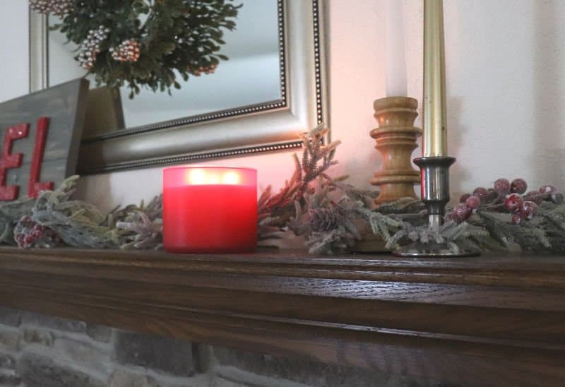 Evergreen christmas mantle with red candle