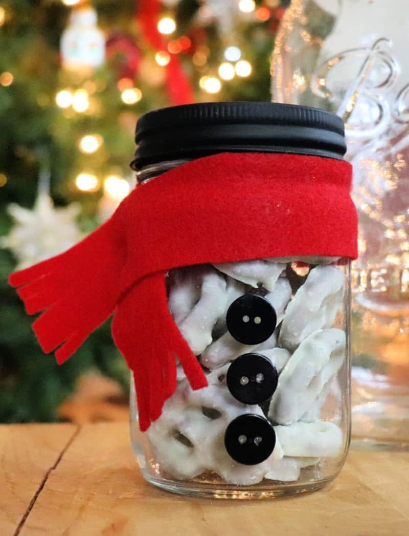 Snowman mason jar gift with white treats