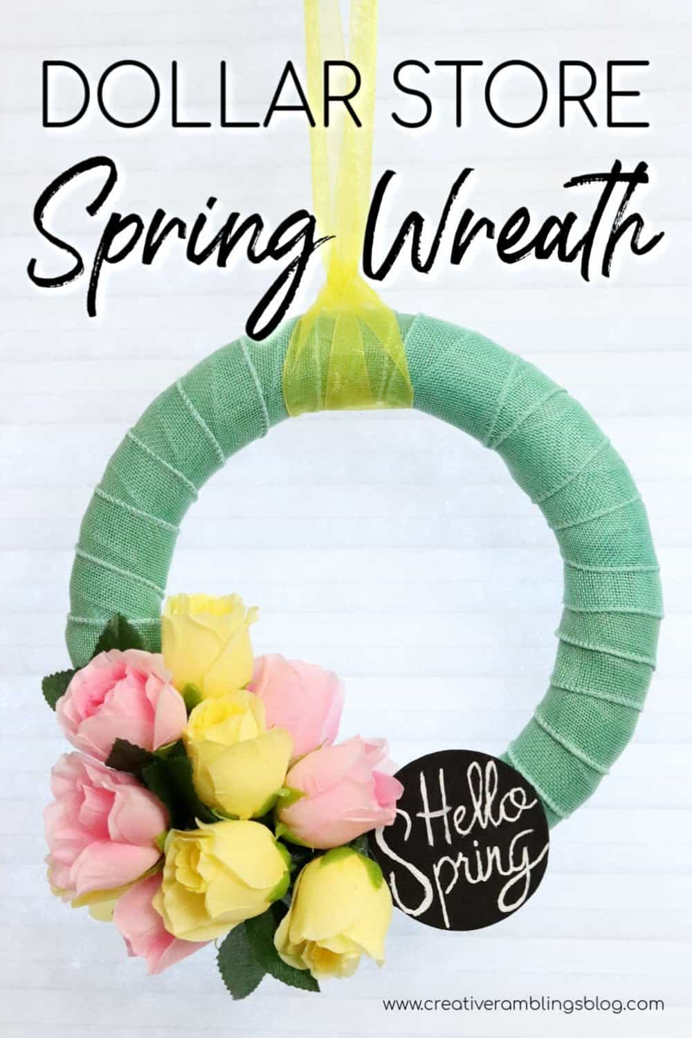 Dollar Store Spring wreath with flowers and chalkboard sign