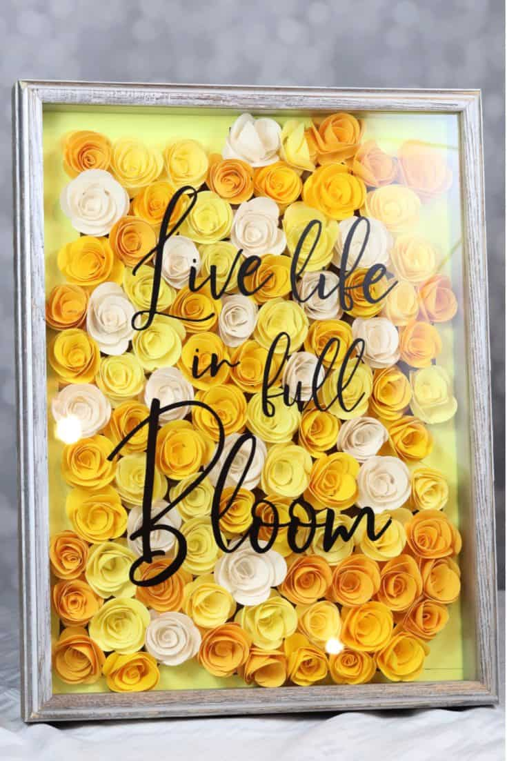 Learn how to make these colorful rolled paper flowers and use them in a shadow box to create bold wall art. #papercraft #silhouette #floral #craft