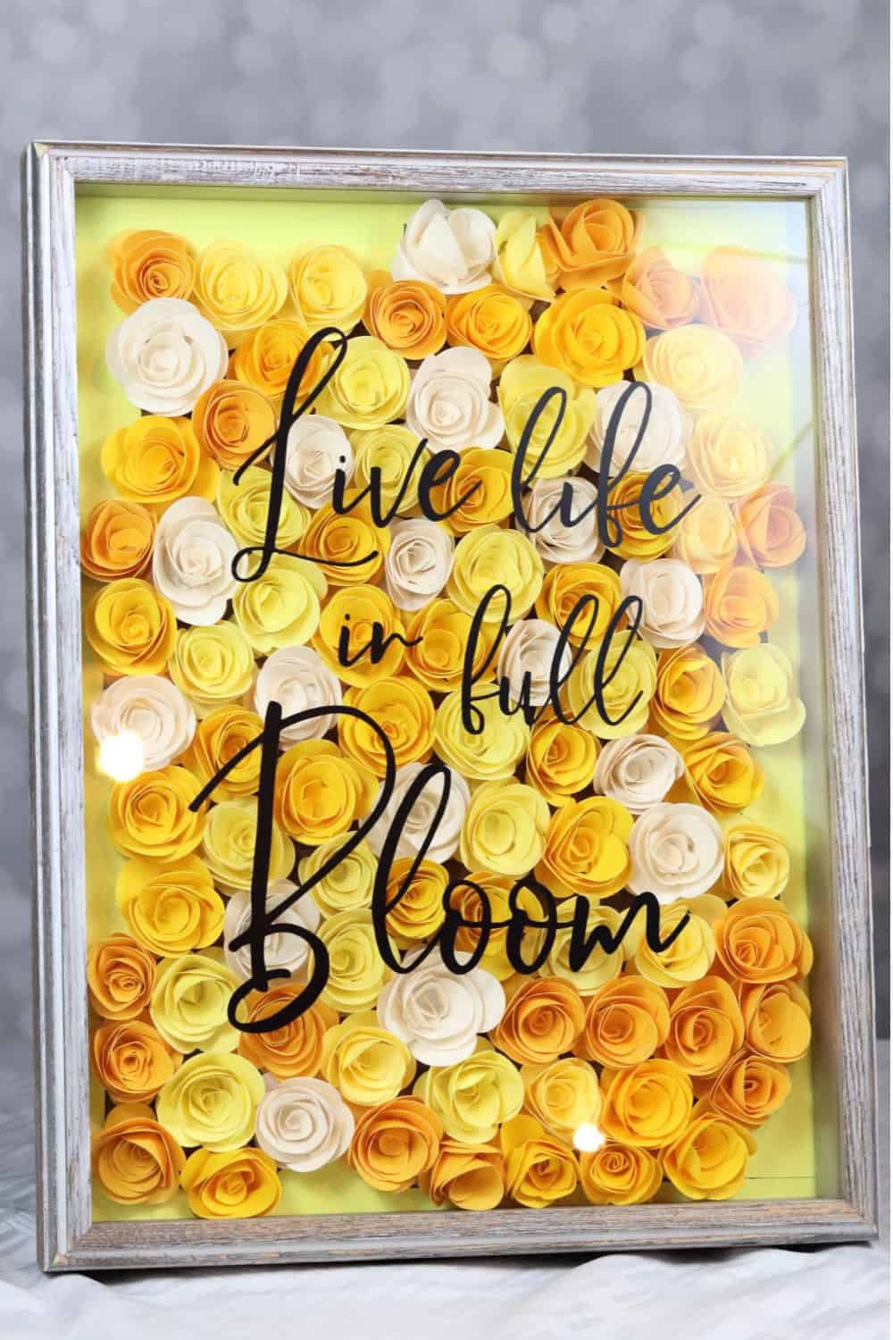 live life in full bloom. DIY rolled paper flower shadow box