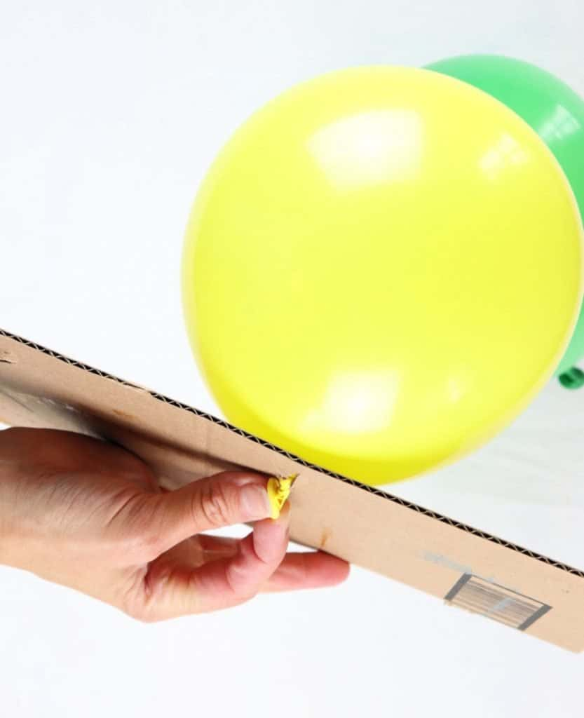 attach balloons to cardboard