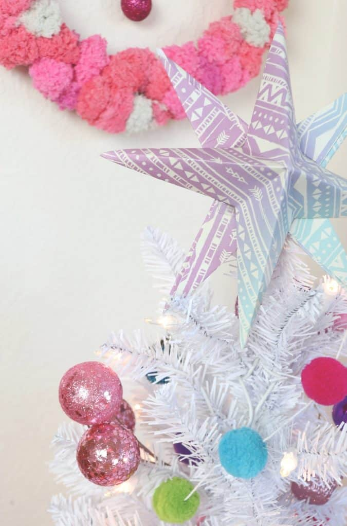 colorful white Christmas tree with paper star topper