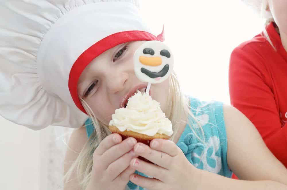 eating a snowman cupcake