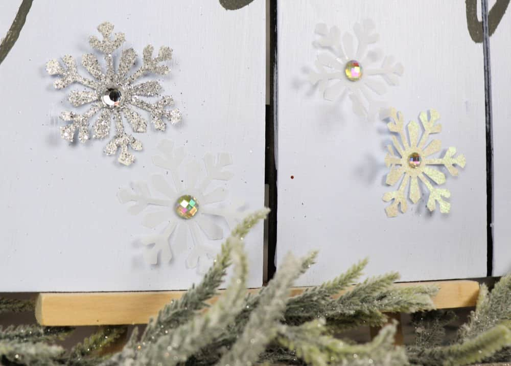 glitter snowflakes on a winter wood sign