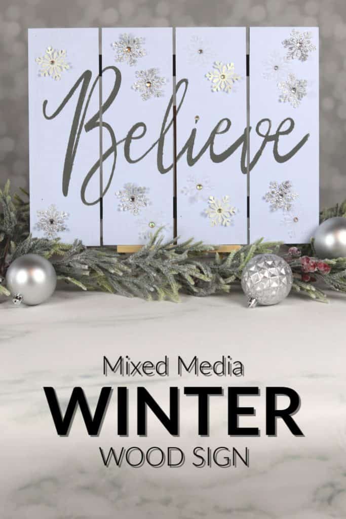 Winter wood sign with believe stencil and glitter snowflakes