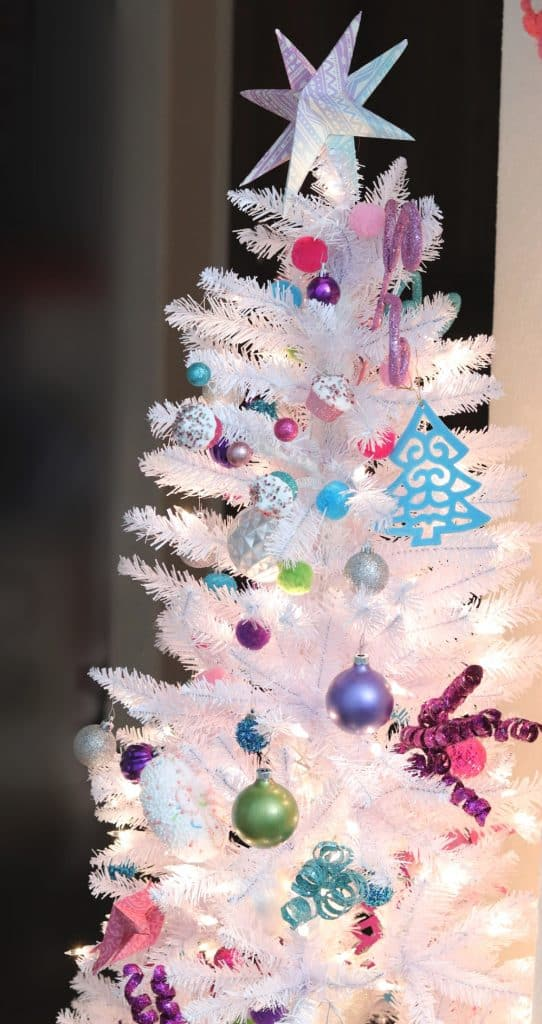 painted-ornaments-on-colorful-white-christmas-tree