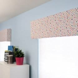 colorful fabric covered window cornice