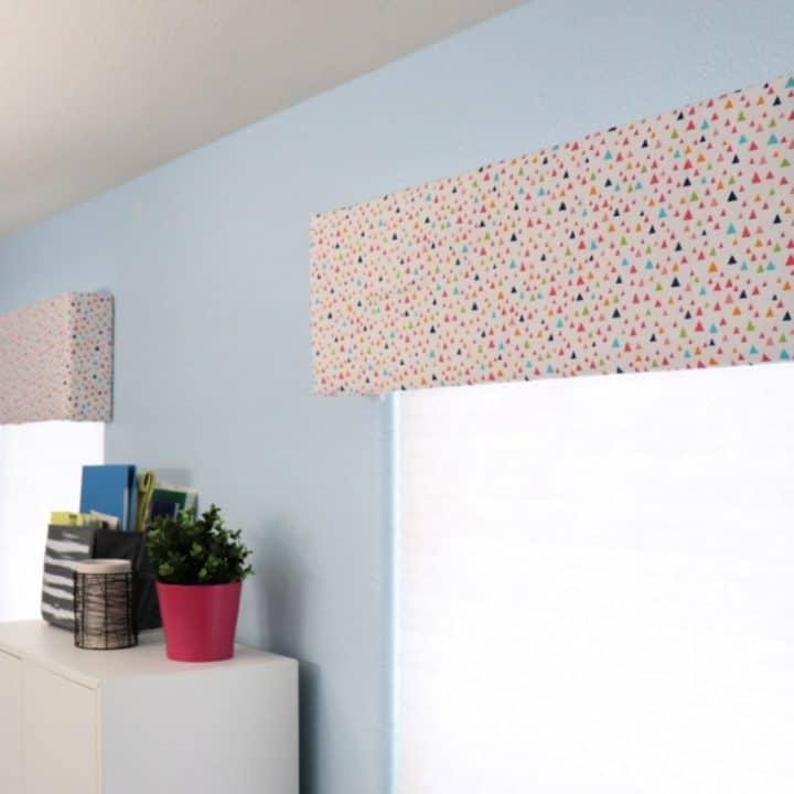 colorful fabric covered window cornice