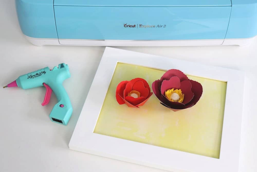 paper flowers in a frame