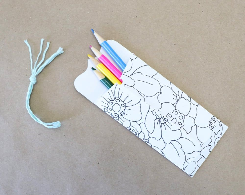 Pencils in coloring bookmark with envelope