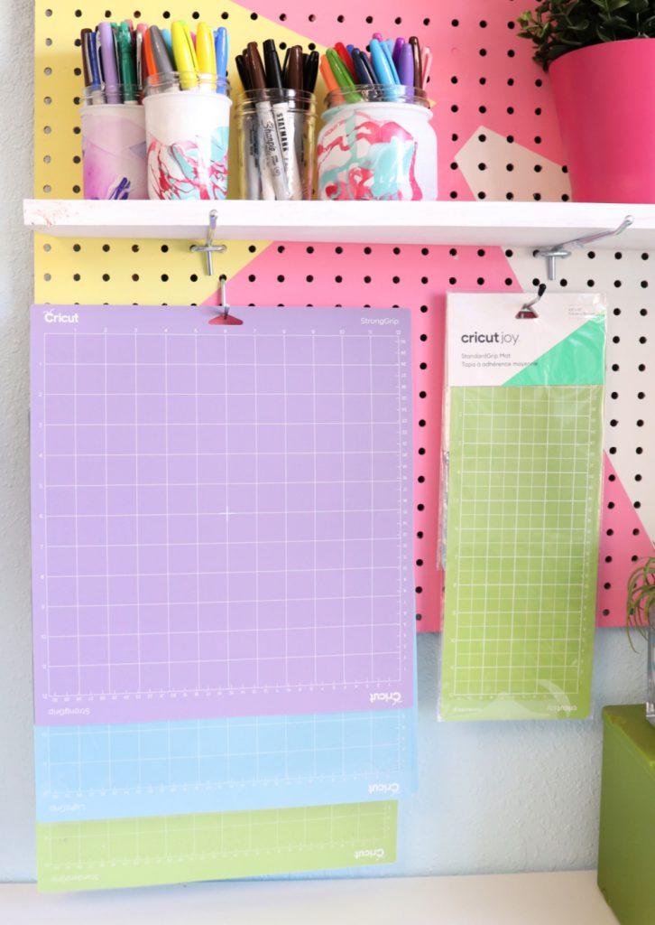 Hang Cricut mats on a peg board