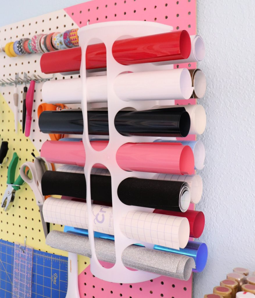 Organize rolls of Cricut vinyl on a wall