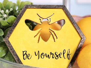 wood sign with iron on bee decor