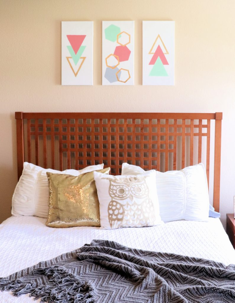 Gold leaf wall art canvas on a wall above a bed