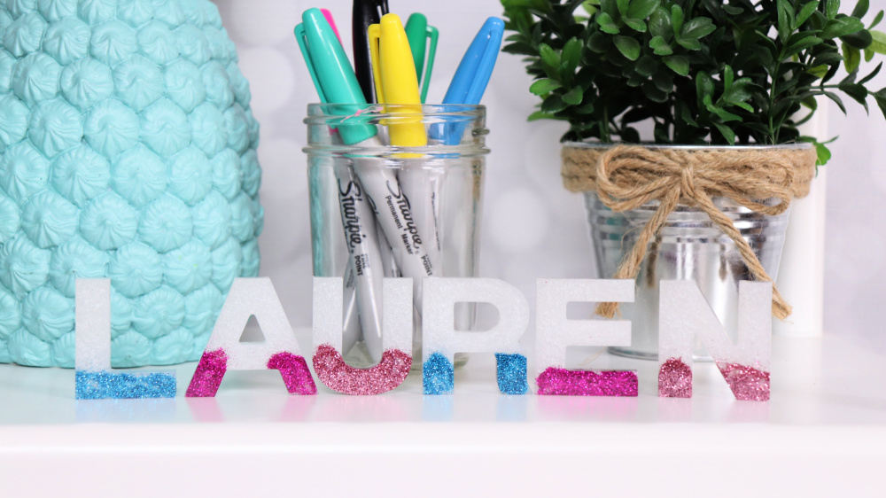 resin letter with eyeshadow and glitter